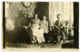 Abe, Della, Belle, and Grandmother Zimmerman in a sitting room in Glidden, Wisconsin