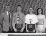 1992-1993 University of Minnesota Duluth Outstanding Senior Athletes Derek Plante and Amy Erickson with University of Minnesota Duluth officials
