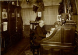 Robert Ross McBurney at his desk at the 23rd Street branch of the New York YMCA