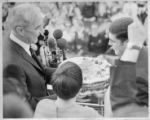 McCarthy Being Given a Cake by a Man