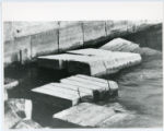 Construction of Glensheen pier and boathouse, blocks in water