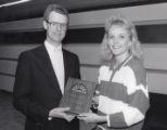 1988 Northern Sun Conference Scholar Athlete Tara Haiskanen with University of Minnesota Duluth Vice Chancellor Greg Fox