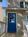 A freshly painted blue door on a house in Duluth