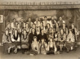 Ukrainian Twin Cities Folk Ballet posing on stage, with Alexander Granovsky
