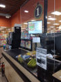 Cashier station with plexiglass shield at Plaza Super One grocery store