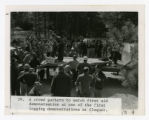 A crowd gathers to watch first aid demonstration at one of the first logging demonstrations in Cloquet