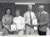 1988-1989 University of Minnesota Duluth Scholar Athletes of the Year Kathy Jedrzejek and Dean Borgh with University of Minnesota Duluth officials