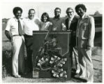 Photograph of Archie Givens, Sr., Archie Givens, Jr., and Others