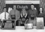 1994-1995 University of Minnesota Duluth Outstanding Senior Athletes Marc Achterkirch, Kristi Duncan, and Jeff Wallace with University of Minnesota Duluth officials