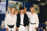Actors of Aleksis Kivi's play THE SEVEN BROTHERS in front of Finnish knife stand at FinnFest '97