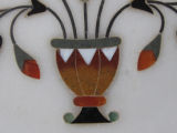 Marble plate with inlaid semi precious stones