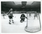 Bulldog hockey players in action during game, near goal
