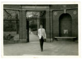 Robert Bly in front of Harvard Gate