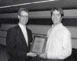 1988 Northern Intercollegiate Conference Britton Award for Distinguished Academic Excellence awardee Thomas Aney with University of Minnesota Duluth Vice Chancellor Greg Fox