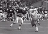 Action shot of University of Minnesota Duluth men's football player with ball