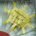"""A sunshine-shaped sign reading """"Kindergartners...You Are My Sunshine"""" in a window of Lester Park School in Duluth, Minnesota"""