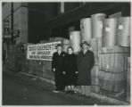 Abe Bloomenson standing next to packages of clothing collected for Israel from Duluth, Minnesota