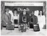 1993-1994 University of Minnesota Duluth Outstanding Senior Athletes Julie Bubar, Chris Marinucci, and Ron McClure with University of Minnesota Duluth officials