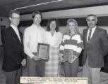 1987-1988 University of Minnesota Duluth Scholar Athletes Tom Aney and Tara Haiskanen with University of Minnesota Duluth officials