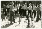 Al Alm demonstrating tree planting tools at MN Department of Natural Resources workshop (2 of 2)