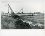 Construction of Glensheen pier and boathouse, with workers on pier