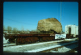 125-150 ton granite glacial boulder from excavation for new domed stadium on way to new home at Plymouth 1st National Bank