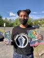 Abbey DeLisle holding cloth masks, #MaskUpMN