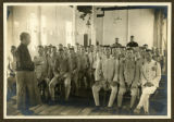A Bible Class in the Army Department being taught by one of the local pastors. Secretary C.C. Ho and an Army Officer standing a