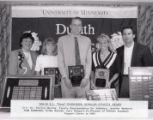 "1994-1995 University of Minnesota Duluth E.L. ""Duce"" Rasmussen Scholar-Athlete awardees Jennifer Madland, Nick Anderson, and Kristi Duncan with University of Minnesota Duluth officials"