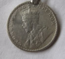 Keychain with George V silver rupee
