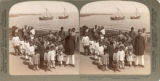 A Parsi schoolmaster and his class of boys, Island of Uran, N. W. toward Bombay