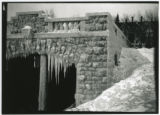 Glensheen boathouse covered in ice. Main house is visible in background