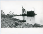 Construction of Glensheen pier and boathouse, with shoreline and workers