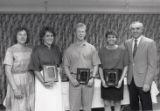 1989 University of Minnesota Duluth Outstanding Senior Athletes Ann Patet, Trevor Lundgren, and Denise Holm with University of Minnesota Duluth officials