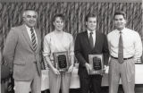 "1990 University of Minnesota Duluth E.L. ""Duce"" Rasmussen Scholar-Athlete awardees Mary Marcella and Paul Shromoff with University of Minnesota Duluth officials"